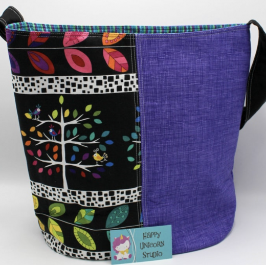 bright-cloth-bag-with-purple-and-a colorful-tree-design
